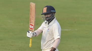 Abhinav Mukund raises his bat after reaching a fifty