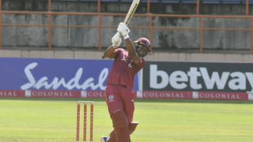 Evin Lewis hits down the ground during his hundred