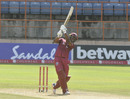 Evin Lewis hits down the ground during his hundred, West Indies v Ireland, 3rd ODI, Grenada, January 12, 2020