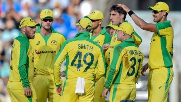 Pat Cummins is congratulated by Mitchell Starc for a wicket