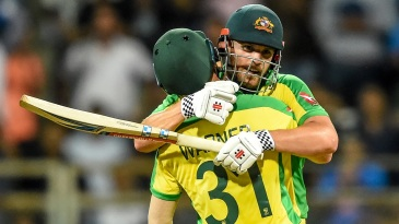 Aaron Finch and David Warner embrace after bringing up the winning runs