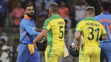 Virat Kohli congratulates Aaron Finch and David Warner
