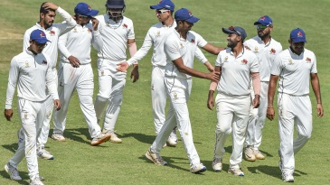 Shams Mulani is mobbed by his team-mates