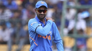 Shikhar Dhawan grimaces after hurting his shoulder while fielding