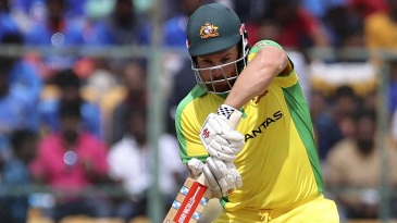 Aaron Finch drives one through cover