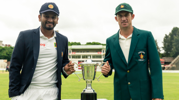 Dimuth Karunaratne and Sean Williams with the series trophy