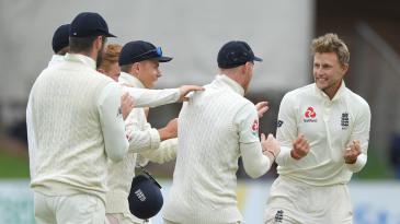 Joe Root celebrates after taking the wicket of Pieter Malan