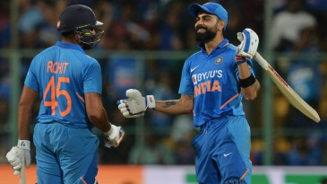 Virat Kohli congratulates Rohit Sharma with a broad grin