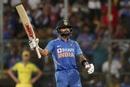 Virat Kohli celebrates a landmark, India v Australia, 3rd ODI, Bengaluru, January 19, 2020