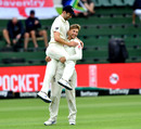 Joe Root and Mark Wood of England celebrate the wicket of Faf du Plessis, South Africa v England, 3rd Test, Port Elizabeth, 4th day, January 19, 2020