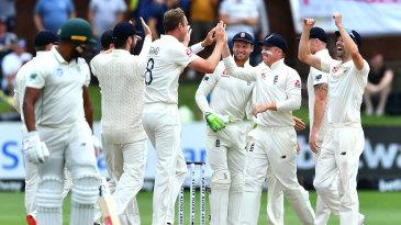 Stuart Broad celebrates with his team-mates