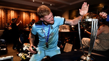 Ben Stokes looks to give the World Cup trophy a high-five