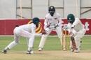 Donald Tiripano stretches forward to defend, Zimbabwe v Sri Lanka, 1st Test, Harare, 2nd day, January 20, 2020