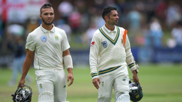 Dane Paterson and Keshav Maharaj leave the field together after their 99-run last-wicket stand