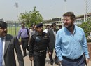 Alistair Campbell, the head of the security delegation from Zimbabwe inspects the Gaddafi Cricket Stadium with Pakistani cricket officials, Lahore, May 6, 2015