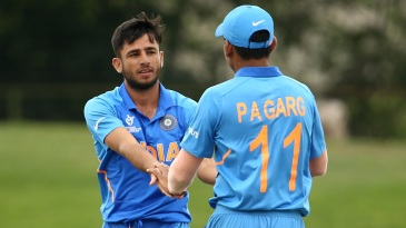 Ravi Bishnoi and Priyam Garg celebrate a wicket