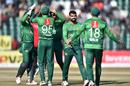 Pakistan gather around Shadab Khan after the dismissal of Tamim Iqbal, Pakistan v Bangladesh, 1st T20I, Lahore, January 23, 2020
