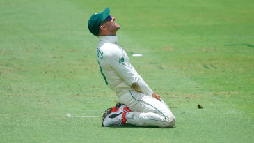 Faf du Plessis grimaces after dropping a catch
