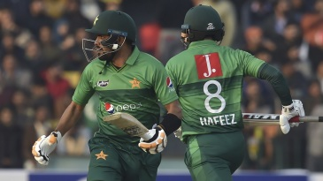 Babar Azam and Mohammad Hafeez take a run during their stand
