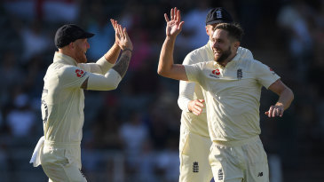 Chris Woakes celebrates the dismissal of Faf du Plessis