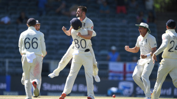 Mark Wood celebrates the wicket of Rassie van der Dussen