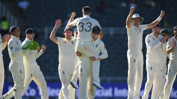 Mark Wood is lifted aloft after taking his final wicket