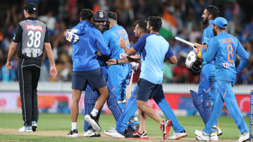 Rohit Sharma is mobbed after clinching the win