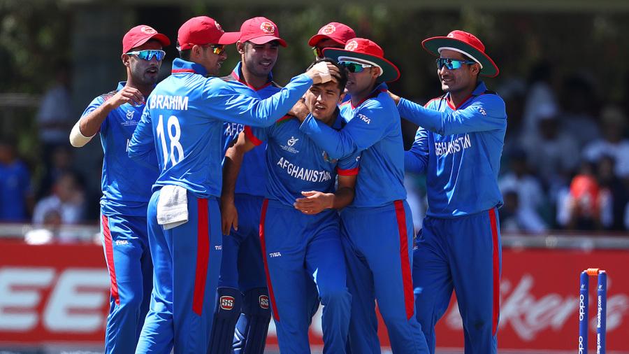 Fazal Haque is congratulated by his team-mates