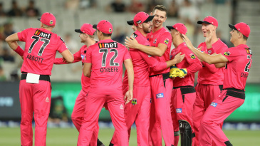 Josh Hazlewood celebrates with his teammates after taking the wicket of Pete Handscomb