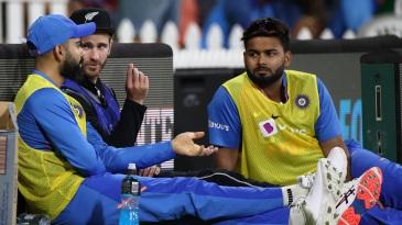 Rishabh Pant listens in as Virat Kohli and Kane Williamson have a chat