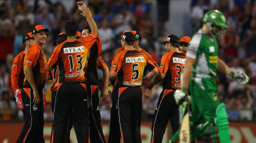 Luke Wright walks off as Perth Scorchers celebrate during the 2011-12 final