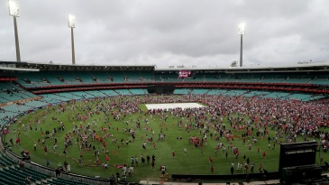 Fans swarm the SCG after the Sixers v Renegades game