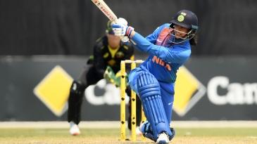 Smriti Mandhana slog-sweeps on the way to her half-century