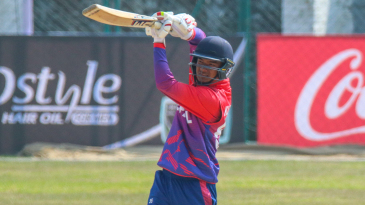 Kushal Malla drives over mid-off for a boundary