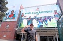 Mushfiqur Rahim strikes a happy pose in front of a poster of the world champions, Dhaka, February 12, 2020