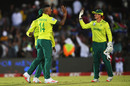 Beuran Hendricks and Quinton de Kock celebrate the end of Jason Roy's knock, South Africa v England, 1st T20I, East London, February 12, 2020