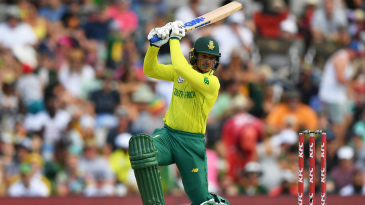Quinton de Kock launches one over the covers