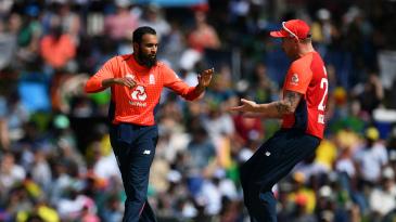 Adil Rashid celebrates with Jason Roy