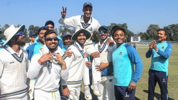 Shahbaz Ahmed is being carried by his team-mates after taking Bengal into the knockouts