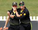 Nicola Carey (left) is congratulated on her catch to remove Smriti Mandhana, Australia v India, T20I tri-series, Junction Oval, February