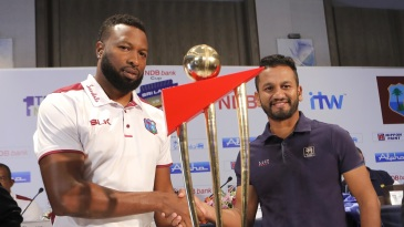 Kieron Pollard and Dimuth Karunaratne pose with the series trophy