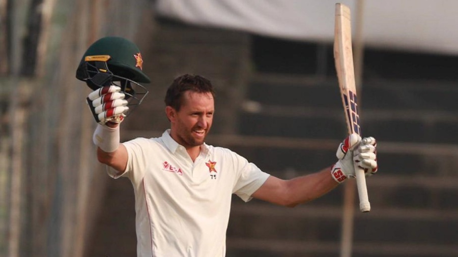 Craig Ervine acknowledges the applause after reaching his century