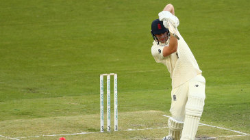 Dan Lawrence drives during his hundred