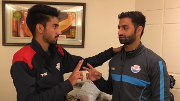 Mujtaba Yousuf (L) and Aquib Nabi compare bowling grips