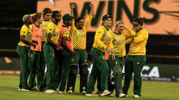 Mignon Du Preez and Dane van Niekerk lead their team in celebration after defeating England