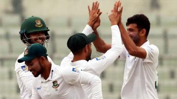 Nayeem Hasan celebrates a dismissal