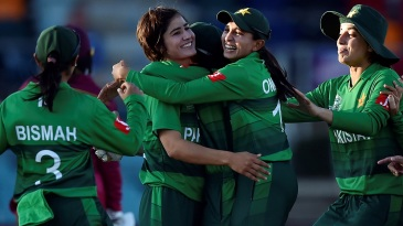 Diana Baig is congratulated by her team-mates