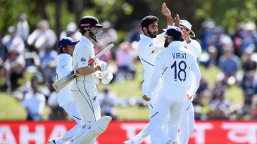 Kane Williamson walks off as India celebrate