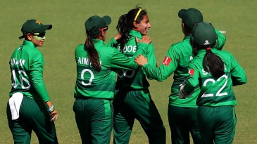 The Pakistan players celebrate a wicket