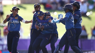 Shashikala Siriwardene is mobbed by her team-mates after picking up a wicket